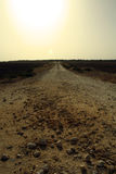 The Road through the Wilderness. Dirt road leading to a new destination Stock Photo