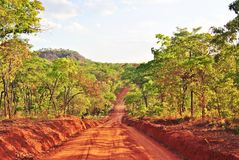 Road through the wilds of northern Mozambique. Travelling through the wilderness of Niassa in northern Mozambique Stock Image