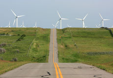 Road Through Wind Farm Stock Photography