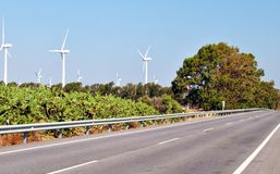 Road with wind turbine. Road in foreground with wind turbines wind power generators in the background Royalty Free Stock Photography