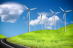 Road and wind turbines Royalty Free Stock Images