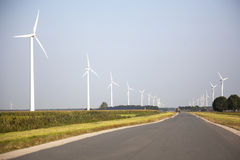 Road and wind turbines in the dutch province of Flevoland Stock Photos