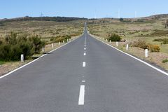 Road with wind turbines at Madeira Island, Portuga Royalty Free Stock Photography
