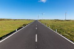 Road with wind turbines at Madeira Island, Portugal Royalty Free Stock Image