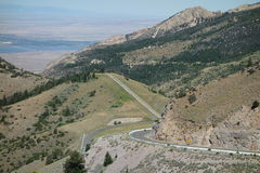 A road winding down the side of a mountain in wyoming. Royalty Free Stock Images