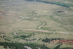 A road winding down the side of a mountain in wyoming. Royalty Free Stock Image