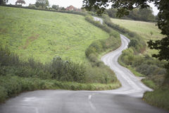 Road Winding Its Way Through Countryside Stock Photo