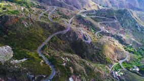 Road winding in mountains. Aerial view of road winding in mountains stock footage