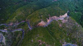 Road winding in mountains. Aerial view of road winding in mountains stock video footage