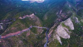 Road winding in mountains stock video footage