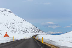 Road winding through snowy mountain pass scenery Stock Photo