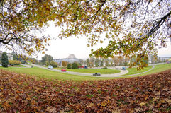 Road winding to the bridge with autumn leaves in the foreground Royalty Free Stock Image