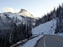 Road winding through wintry, mountainous landscape Royalty Free Stock Photo
