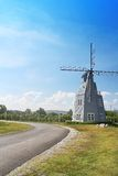 Road with windmill and blue sky Royalty Free Stock Image