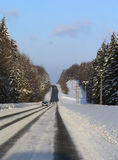 Road in winter. Snowy road in winter with one car Royalty Free Stock Photography