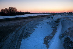 Road through winter field Royalty Free Stock Photos