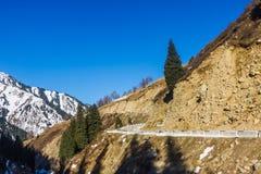 Road in winter mountains in Kazakhstan Royalty Free Stock Image