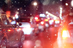 Road in winter night traffic jams snow city Stock Image