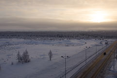 Road in the winter north street. Evening, sunset.  Royalty Free Stock Photo