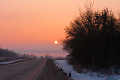 Road winter sunset Stock Photography