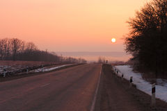 Road winter sunset Royalty Free Stock Image