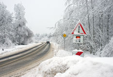Road through wintry forest Stock Photo