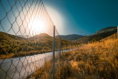 Road and wired. Road crossing wired under sun stock photography