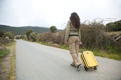 Road woman and suitcase Royalty Free Stock Photography