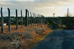 A road with wooden posts Royalty Free Stock Photo