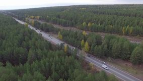 The road in the woods with lots of traffic. Asphalt road, a lot of cars going around the forest and railway. Summer, Russia stock video footage
