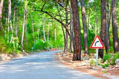Road in the woods and sign of rotation Royalty Free Stock Images