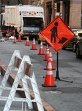 Road Work. Blocked off road with orange cones and caution sign Stock Images