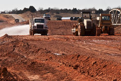 Road Work. Tanker truck wetting down a new road bed Royalty Free Stock Images