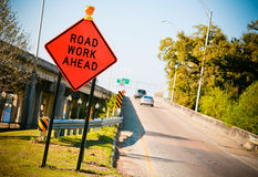 Road Work Ahead. Construction warning sign on the side of a highway onramp stock photo