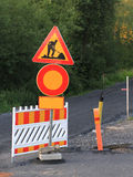 Road work ahead. Road work signs with an walking road under construction in the background royalty free stock image