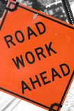 Road Work Ahead. An orange road sign that reads ROAD WORK AHEAD Royalty Free Stock Images