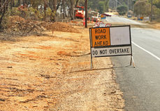 Road Work Ahead, Do Not Overtake sign Stock Photography