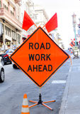 Road work ahead. Orange sign on the street stock image