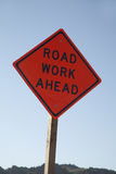 `Road Work Ahead` Road Sign. A sign on an American highway saying `Road Work Ahead Stock Photography