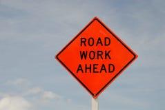Road work ahead sign. Against blue sky stock photos