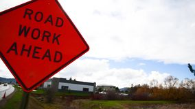 Road work ahead sign stock video