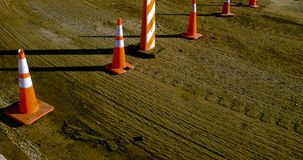 Road work cones. A road work scene with orange cones. Colorful and texture rich picture that can work as a background Stock Photography