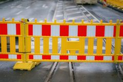 Road work fence  in city street Stock Photos