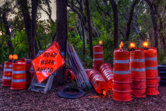 Road Work Interrupted. Roadwork signs at rest except for the lights Royalty Free Stock Image