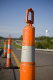 Road work pylons. On onramp of hiway indication construction Royalty Free Stock Images