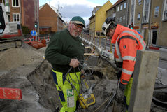 ROAD WORKER. COPENHAGEN/DENMARK_Road construction labour worker working at Kastruplundgade and norrebro station in heart of city and whole Copenhagen city road Royalty Free Stock Image