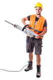 Road Worker with Jackhammer. A young road worker wearing a hardhat and a visibility vest holding a jackhammer isolated over white background Stock Image