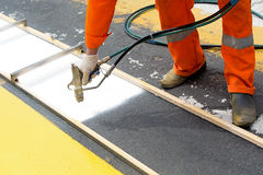 Road worker painting zebra crossing sign Royalty Free Stock Images