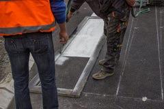 Road worker spraying pedestrian crosswalks 4. Road worker spraying pedestrian crosswalks with hand spraying equipment Royalty Free Stock Photos