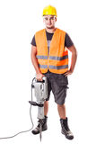 Road Worker. A young road worker wearing a hardhat and a visibility vest holding a jackhammer isolated over white background Stock Photos